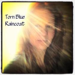 Torn Blue Raincoat